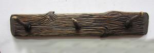 Immagine di appendiabiti da parete a 3 posti corna cervo legno intagliato