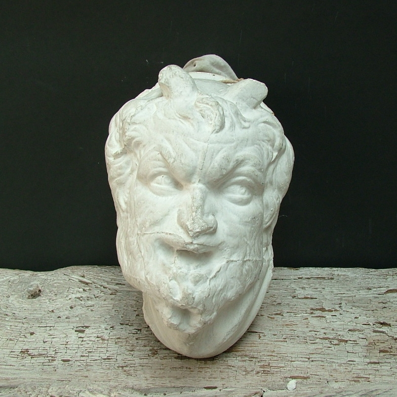 Picture of Plaster cast high-relif of an head of a faun