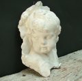 Picture of head of a Duquesnoy's little angel high-relif made in plaster