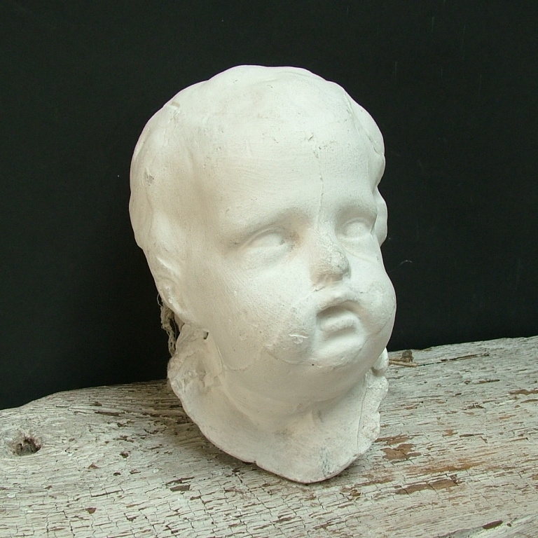 Picture of Plaster cast high-relif of an head of a putto