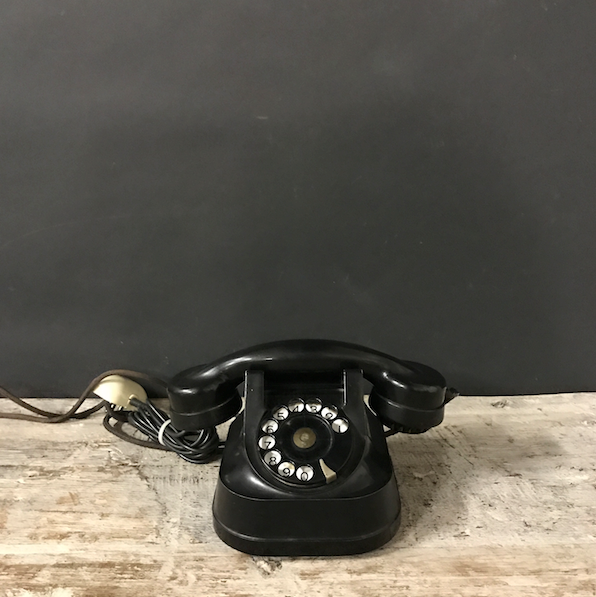 Picture of Bakelite  and iron black telephone from 40s / 50s