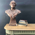 Picture of Plaster cast old woman sculpture painted in bronze