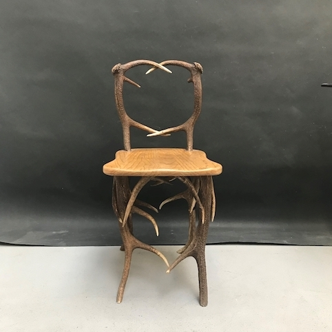 Picture of chair with deer antler