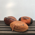 Picture of Vintage rugby, soccer, volleyball, basketball, american football balls.