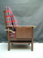 Picture of armchair with table, ashtray, pouf