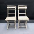 Immagine di Coppia di sedie pieghevoli in legno bianco