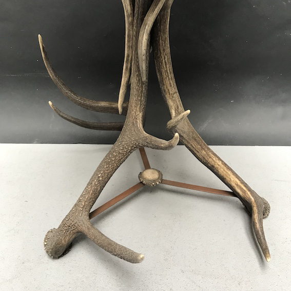 Picture of round tea table with deer and fellow deer antler